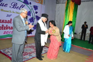 The Principal Mrs Malvika Dube & Dr P.K.Dube honouring the Chief Guest with a shawl and a school Memento