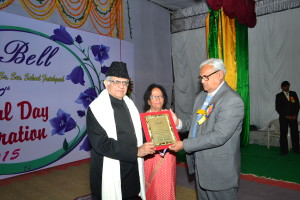 The Principal & Dr. P.K.Dube honouring the Chief Guest with a shawl and a School Memento