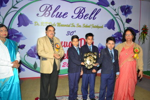 Dr P.M.Mathur giving away shields for Sports Events